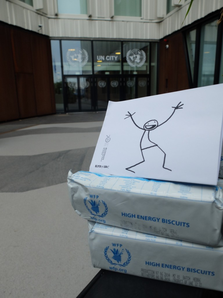 Elyx in front of the UN City waiting to taste the WFP high energy biscuits.